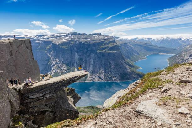 Man making somersault on Trolltunga in Norway stock photo