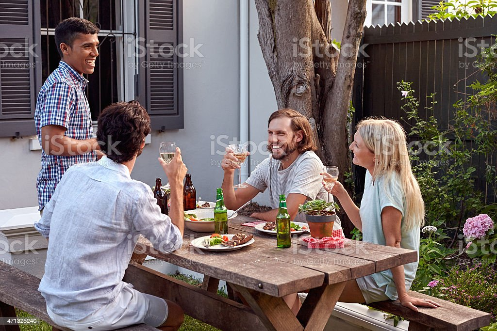 man making speech man toasting speech at friends outdoor garden party with wine drinks 2015 Stock Photo