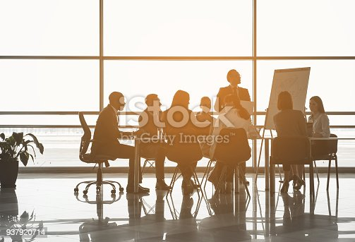 istock Man making startup analysis to colleagues 937920714