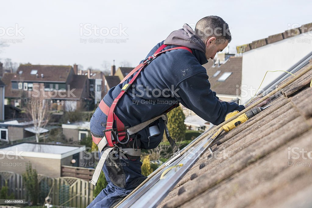 man making the construction for solar panels stock photo