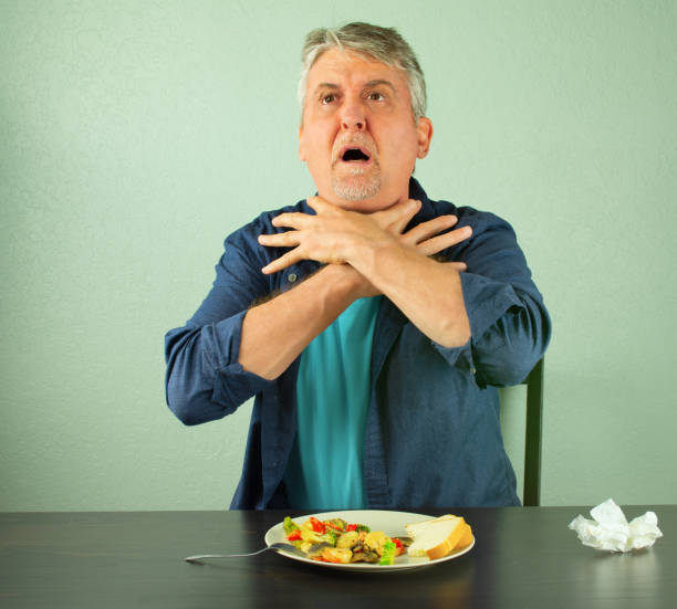 Royalty Free Choking Food Pictures Images And Stock Photos Istock
