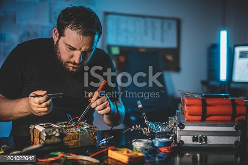 Man making time bomb at night