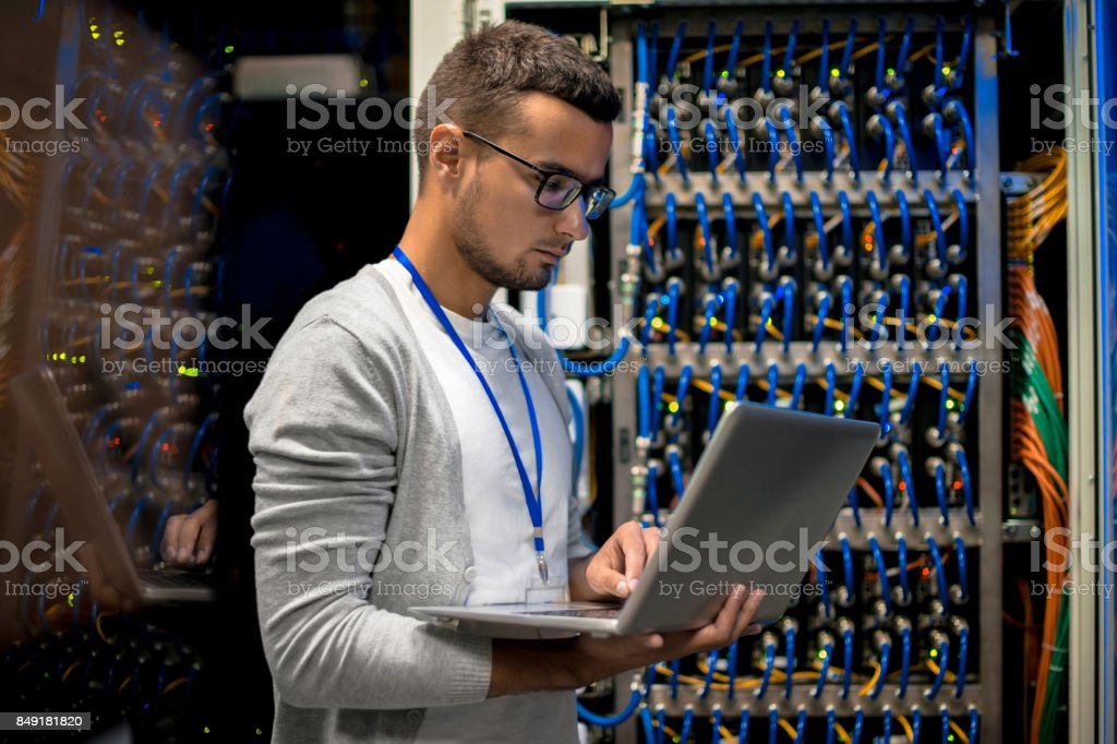 Man Managing Supercomputer Servers stock photo