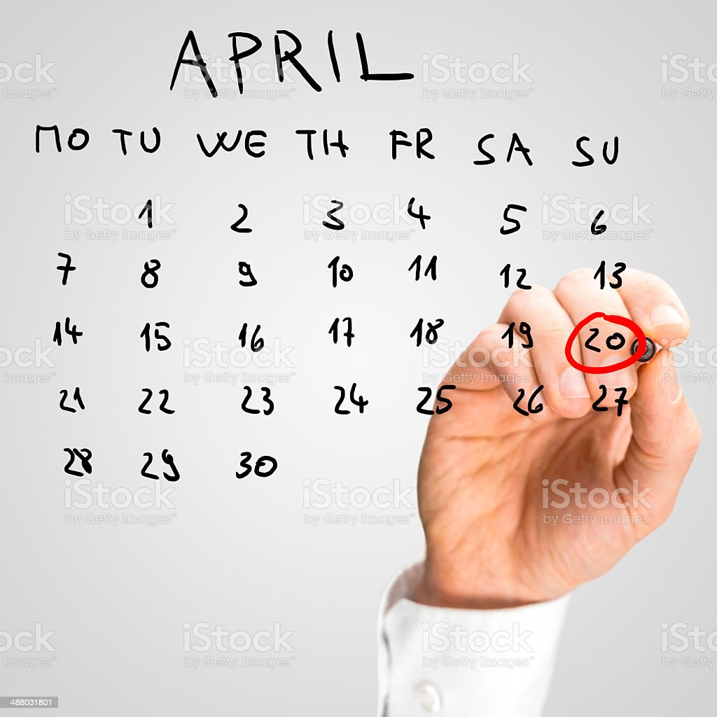 Man marking off Easter Day on the calendar royalty-free stock photo