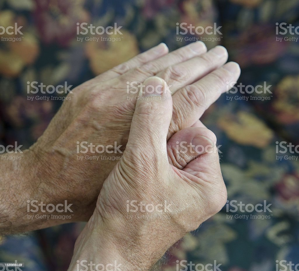 man massaging hands stock photo