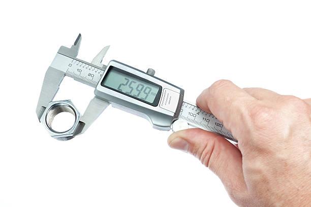 Man measures the piece caliper. Close-up. stock photo