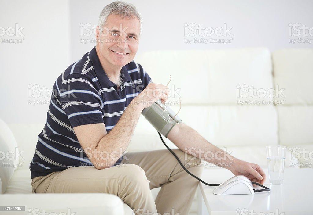 Man measuring blood pressure at home. royalty-free stock photo