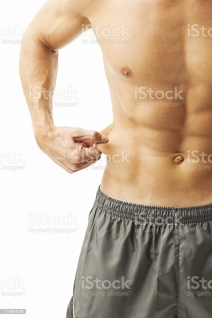 Man Measuring Fat On Belly - Isolated stock photo