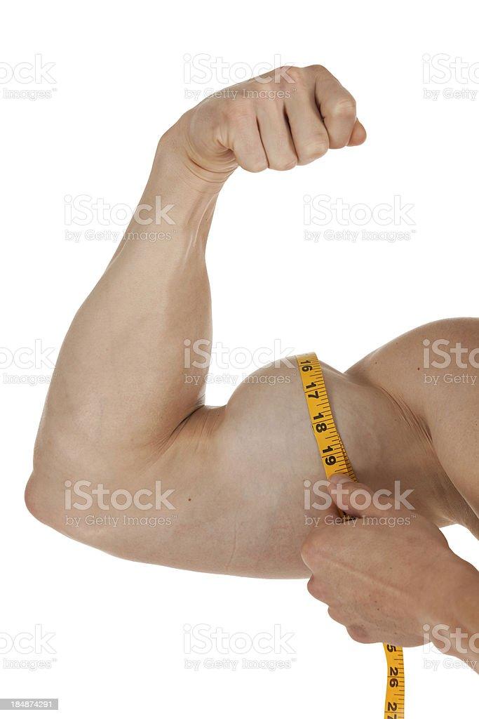 Man measuring his bicep royalty-free stock photo