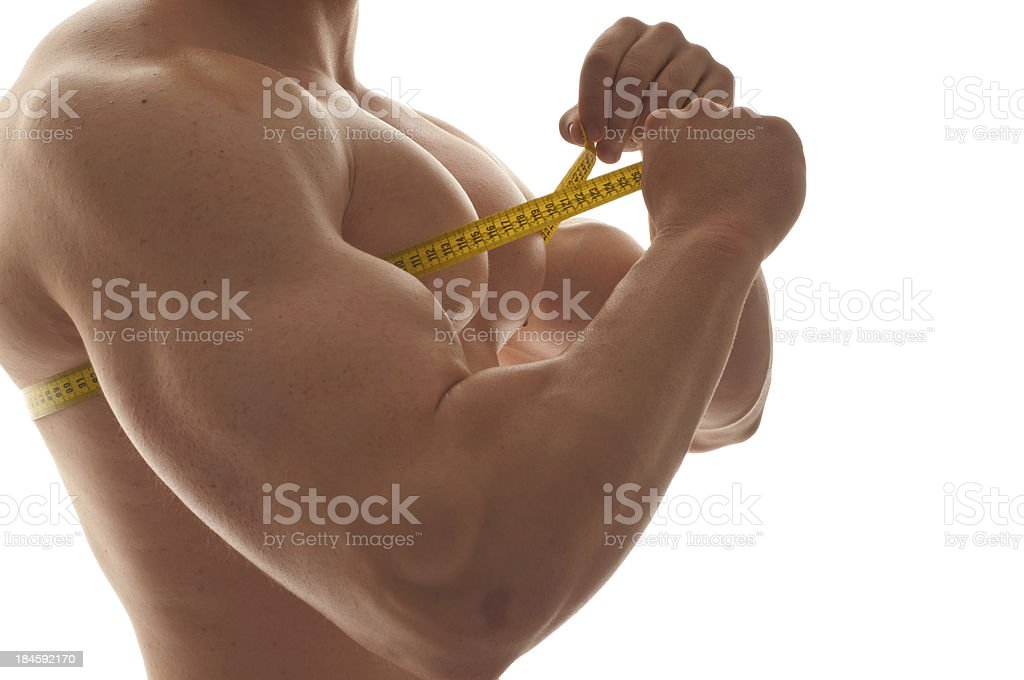 Man measuring his chest with a tape measure royalty-free stock photo