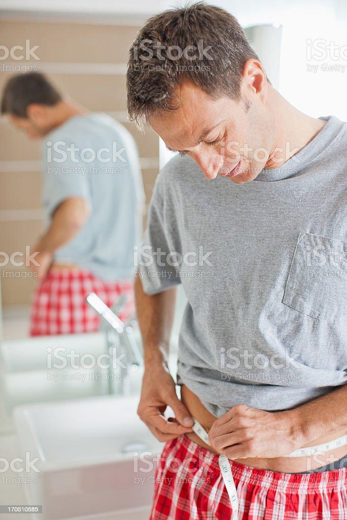 Man measuring waistline royalty-free stock photo