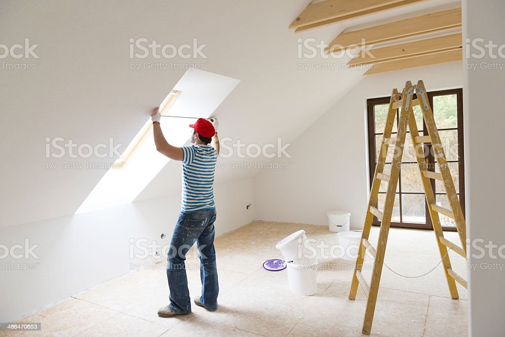 Man measuring walls stock photo