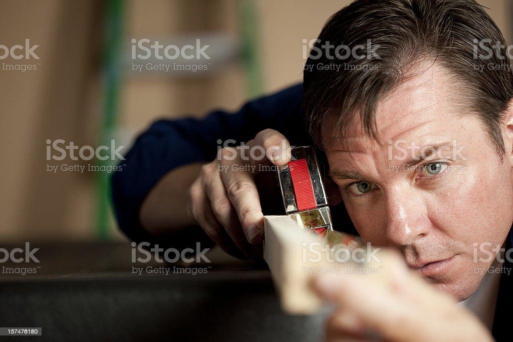 Man Measuring wood royalty-free stock photo