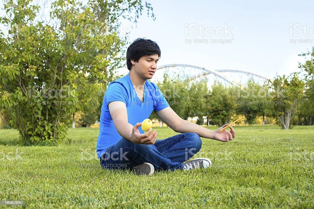 Man meditating in Astana royalty-free stock photo