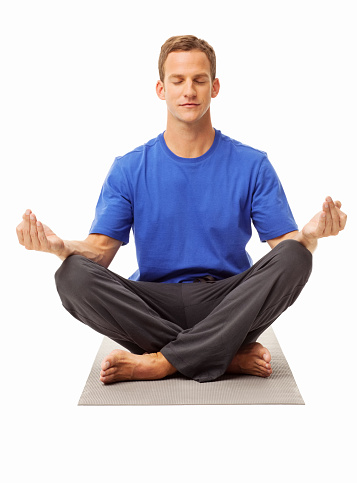 man meditating in lotus position isolated stock photo