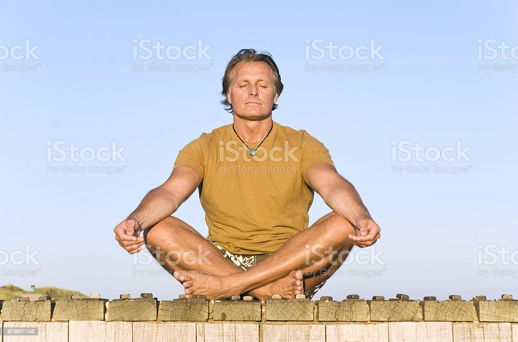 man meditating royalty-free stock photo