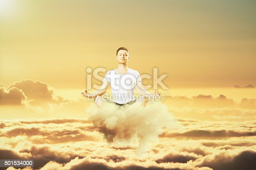 Man meditation in the clouds concept
