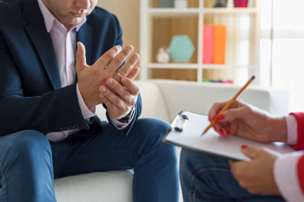Man meeting counselor for marriage consultation stock photo