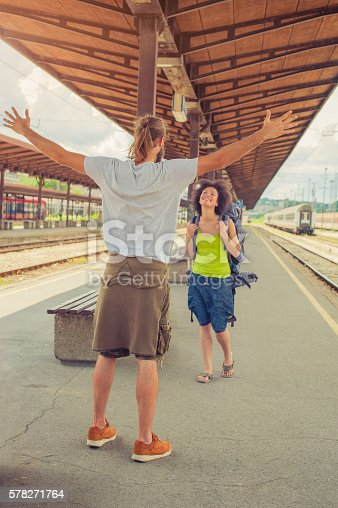 istock Man meeting his girlfriend at the train station 578271764