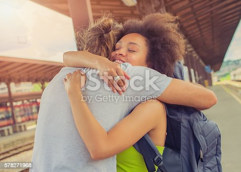 istock Man meeting his girlfriend at the train station 578271968