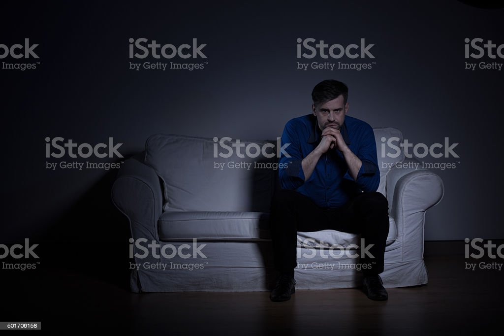Man mentally distraught after funeral stock photo