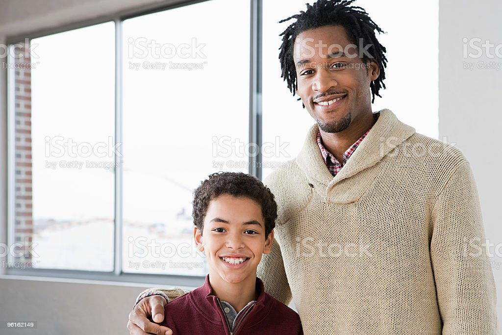Man mentoring boy stock photo