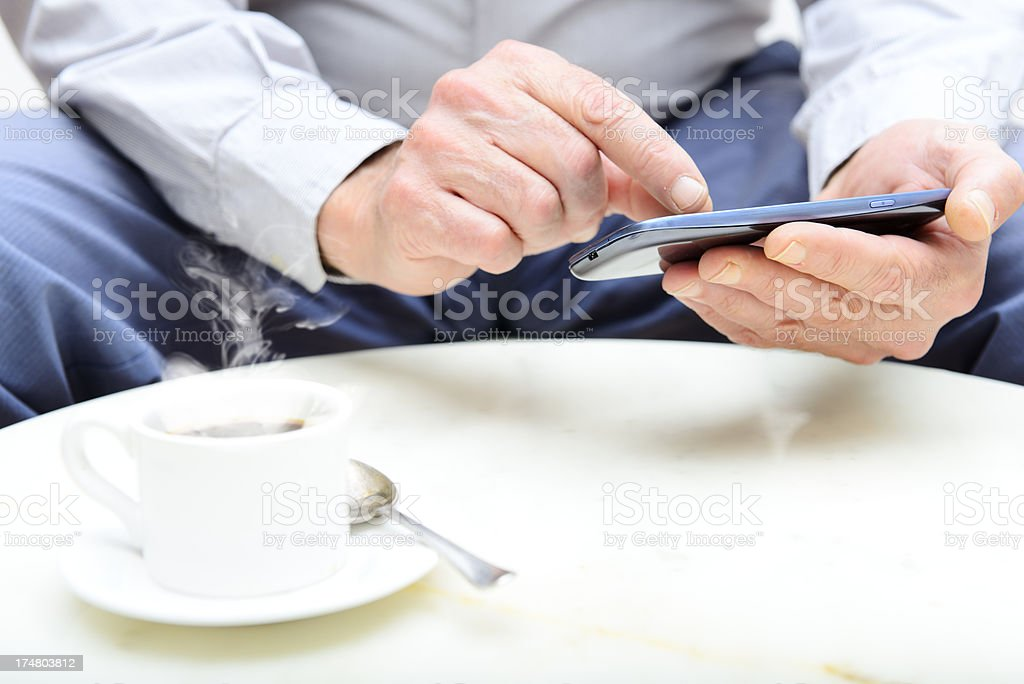 Man Messaging on Smart Phone royalty-free stock photo