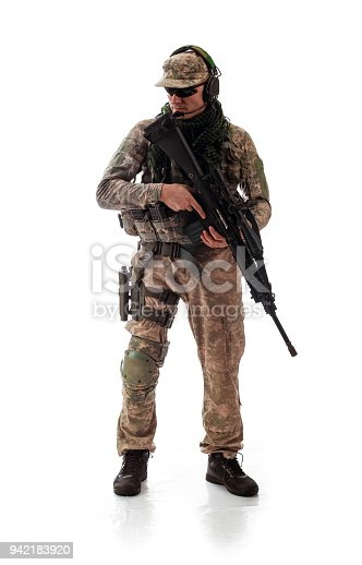 istock man military outfit a soldier in modern times on a white background in studio 942183920