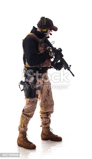 istock man military outfit a soldier in modern times on a white background in studio 942183946
