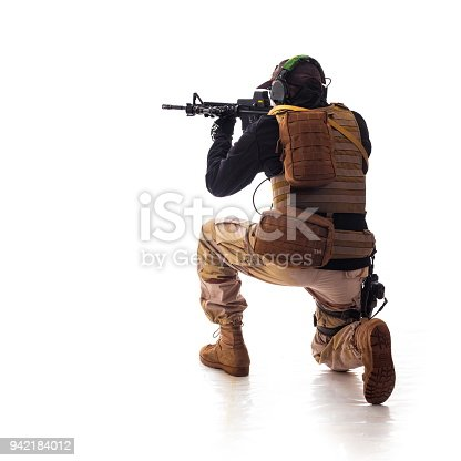 istock man military outfit a soldier in modern times on a white background in studio 942184012
