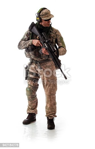 istock man military outfit a soldier in modern times on a white background in studio 942184278