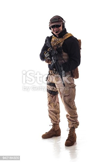 istock man military outfit a soldier in modern times on a white background in studio 942184320