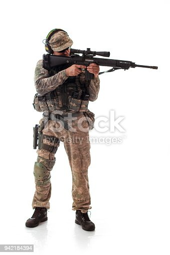 istock man military outfit a soldier in modern times on a white background in studio 942184394
