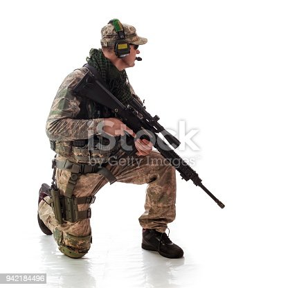 istock man military outfit a soldier in modern times on a white background in studio 942184496