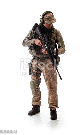 istock man military outfit a soldier in modern times on a white background in studio 942184862