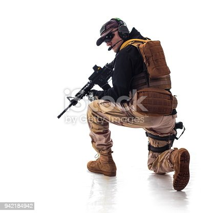 istock man military outfit a soldier in modern times on a white background in studio 942184942