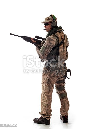 istock man military outfit a soldier in modern times on a white background in studio 942185260