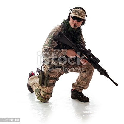 istock man military outfit a soldier in modern times on a white background in studio 942185288
