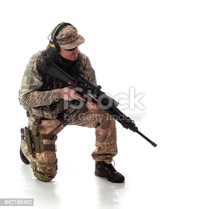 istock man military outfit a soldier in modern times on a white background in studio 942185452