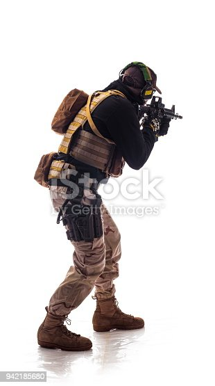 istock man military outfit a soldier in modern times on a white background in studio 942185680