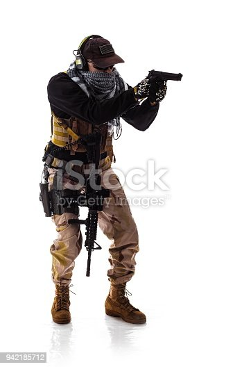 istock man military outfit a soldier in modern times on a white background in studio 942185712
