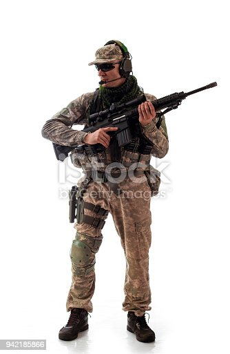 istock man military outfit a soldier in modern times on a white background in studio 942185866