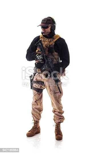 istock man military outfit a soldier in modern times on a white background in studio 942185884