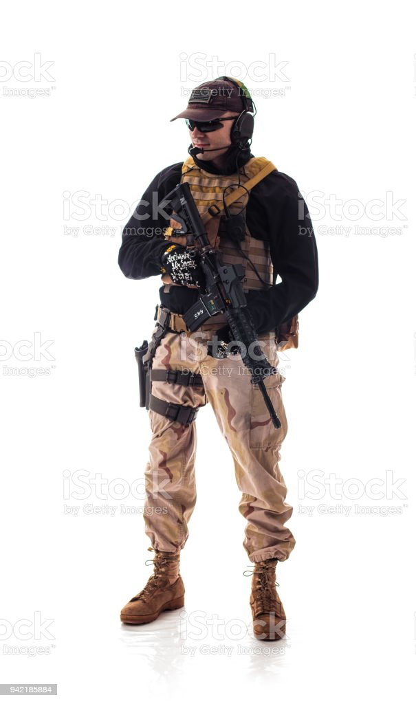 man military outfit a soldier in modern times on a white background in studio stock photo
