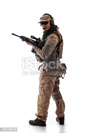 istock man military outfit a soldier in modern times on a white background in studio 942186018