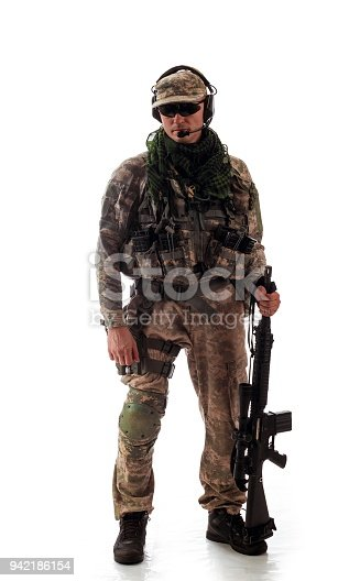 istock man military outfit a soldier in modern times on a white background in studio 942186154
