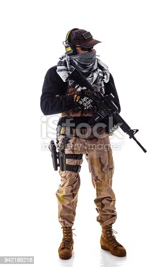 istock man military outfit a soldier in modern times on a white background in studio 942186218