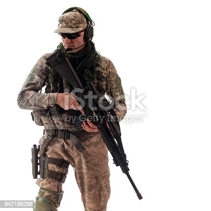 istock man military outfit a soldier in modern times on a white background in studio 942186286