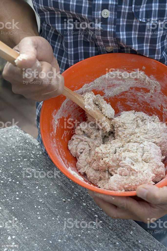 Man Mixing Dough in a Bowl royalty-free stock photo