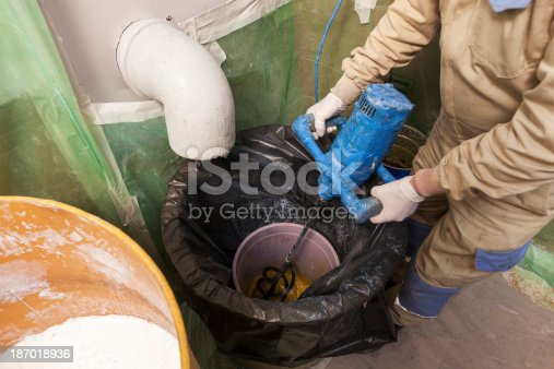 Man mixing glue for yacht isolate